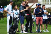 Presenter Dan Walker and broadcaster Piers Morgan in discussion during the BMW PGA Championship Pro Am tournament at Wentworth on May 23, 2018 in Virginia Water, England.