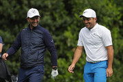 Francesco Molinari of Italy walks with Tim Sherwood during the Pro Am for the BMW PGA Championship at Wentworth on May 23, 2018 in Virginia Water, England.