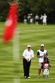 Colin Montgomerie of Scotland talks with his caddie Jason Hempelman as he prepares to play an iron shot during the second round of the BMW PGA Championship on the West Course at Wentworth on May 21, 2010 in Virginia Water, England.