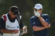 Justin Rose of England and his caddie Mark Fulcher on the 16th hole during the third round of the BMW PGA Championship on the West Course at Wentworth on May 26, 2012 in Virginia Water, England.