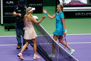 Caroline Wozniacki of Denmark is congratulated by Petra Kvitova of Czech Republic during day five of the BNP Paribas WTA Finals tennis at the Singapore Sports Hub on October 24, 2014 in Singapore.
