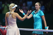 Caroline Wozniacki of Denmark shakes hands at the net after her straight sets victory against Petra Kvitova of the Czech Republic in their round robin match during the BNP Paribas WTA Finals at Singapore Sports Hub on October 24, 2014 in Singapore.