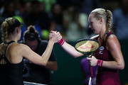 Kiki Bertens of the Netherlands shakes hands with Angelique Kerber of Germany after their singles match during day 2 of the BNP Paribas WTA Finals Singapore presented by SC Global at Singapore Sports Hub on October 22, 2018 in Singapore.