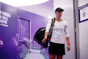 Angelique Kerber of Germany walks onto the court prior to her singles match against Kiki Bertens of the Netherlands during day 2 of the BNP Paribas WTA Finals Singapore presented by SC Global at Singapore Sports Hub on October 22, 2018 in Singapore.