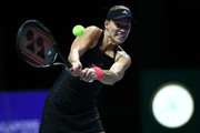 Angelique Kerber of Germany plays a backhand in her singles match against Kiki Bertens of the Netherlands during day 2 of the BNP Paribas WTA Finals Singapore presented by SC Global at Singapore Sports Hub on October 22, 2018 in Singapore.