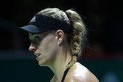 Angelique Kerber of Germany reacts to her shot in her women's singles match against Naomi Osaka of Japan during day 4 of the BNP Paribas WTA Finals Singapore presented by SC Global at Singapore Sports Hub on October 24, 2018 in Singapore. at Singapore Sports Hub on October 24, 2018 in Singapore.