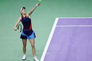 Caroline Wozniacki of Denmark serves in her singles match  with Petra Kvitova of the Czech Republic prior to their singles match during day 3 of the BNP Paribas WTA Finals Singapore presented by SC Global at Singapore Sports Hub on October 23, 2018 in Singapore.  at Singapore Sports Hub on October 23, 2018 in Singapore.