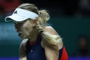 Caroline Wozniacki of Denmark plays a forehand in her singles match with Petra Kvitova of the Czech Republic prior to their singles match during day 3 of the BNP Paribas WTA Finals Singapore presented by SC Global at Singapore Sports Hub on October 23, 2018 in Singapore.  at Singapore Sports Hub on October 23, 2018 in Singapore.