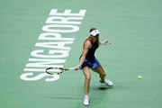 Caroline Wozniacki of Denmark plays a forehand her singles match  with Petra Kvitova of the Czech Republic prior to their singles match during day 3 of the BNP Paribas WTA Finals Singapore presented by SC Global at Singapore Sports Hub on October 23, 2018 in Singapore.  at Singapore Sports Hub on October 23, 2018 in Singapore.