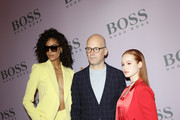 Cindy Bruna, Mark Langer and Madelaine Petsch attend the BOSS fashion show during the Milan Fashion Week Fall/Winter 2020 - 2021 on February 23, 2020 in Milan, Italy.