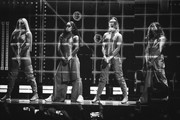 Image has been converted to black and white) (L-R) Jesy Nelson, Leigh-Anne Pinnock, Perrie Edwards and Jade Thirlwall of Little Mix perform during The BRIT Awards 2019 held at The O2 Arena on February 20, 2019 in London, England.