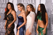 (L-R) Jesy Nelson, Perrie Edwards, Jade Thirlwall and Leigh-Anne Pinnock or the band Little Mix attends The BRIT Awards 2019 held at The O2 Arena on February 20, 2019 in London, England.