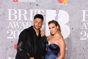 Alex Oxlade-Chamberlain and Perrie Edwards attend The BRIT Awards 2019 held at The O2 Arena on February 20, 2019 in London, England.