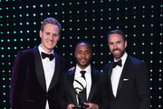 Dan Walker (L) and Gareth Southgate, Manager of England (R) present The Integrity and Impact Award founded by Dow Jones Intelligence to Raheem Sterling (C) during the BT Sport Industry Awards 2019 at Battersea Evolution on April 25, 2019 in London, England. The BT Sport Industry Awards is the biggest commercial sports awards in the world and an annual showcase of the best of the sector's creative and commercial output. The event brings together sports stars, celebrities, industry leaders, influencers and media from around the world for what is always a highly anticipated occasion.