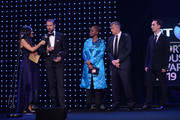 Alex Scott (L) and Baroness Amos (C) present the Leadership in Sport Award to The FA & England World Cup Squad, accepted by Gareth Southgate, Manager of England (second from left), Mark Bullingham, CEO of The FA (R) and Martin Glenn, former CEO of The FA during the BT Sport Industry Awards 2019 at Battersea Evolution on April 25, 2019 in London, England. The BT Sport Industry Awards is the biggest commercial sports awards in the world and an annual showcase of the best of the sector's creative and commercial output. The event brings together sports stars, celebrities, industry leaders, influencers and media from around the world for what is always a highly anticipated occasion.