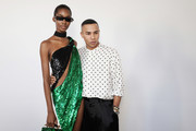 Designer Olivier Rousteing poses with model Tami Williams backstage ahead of the Balmain Womenswear Spring/Summer 2020  show as part of Paris Fashion Week on September 27, 2019 in Paris, France.