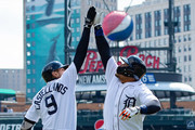 Miguel Cabrera #24 of the Detroit Tigers hits a solo home run in the sixth inning and gets a hi-five from teammate Nicholas Castellanos #9 against the Baltimore Orioles ring a MLB game at Comerica Park on April 18, 2018 in Detroit, Michigan. The Tigers defeated the Orioles  6-2.