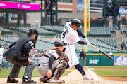 Miguel Cabrera #24 of the Detroit Tigers hits a first inning double against the Baltimore Orioles during a MLB game at Comerica Park on April 18, 2018 in Detroit, Michigan.