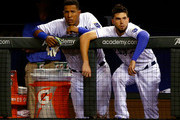 Salvador Perez #13 and Eric Hosmer #35 of the Kansas City Royals watch from the dugout during the game against the Baltimore Orioles at Kauffman Stadium on August 26, 2015 in Kansas City, Missouri.