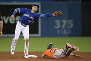 Craig Gentry #14 of the Baltimore Orioles steals second base in the ninth inning during MLB game action as Troy Tulowitzki #2 of the Toronto Blue Jays reaches for the throw at Rogers Centre on April 15, 2017 in Toronto, Canada. All players are wearing #42 in honor of Jackie Robinson Day.
