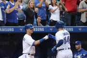 Justin Smoak #14 of the Toronto Blue Jays is congratulated by Troy Tulowitzki #2 after hitting a solo home run in the fourth inning during MLB game action against the Baltimore Orioles at Rogers Centre on June 28, 2017 in Toronto, Canada.