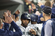 Nelson Cruz #23 of the Seattle Mariners is greeted in the dugout after scoring on a double by Ryon Healy #27 in the eighth inning against the Baltimore Orioles at Safeco Field on September 4, 2018 in Seattle, Washington.