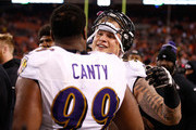 Brent Urban #96 of the Baltimore Ravens celebrates his blocked field goal that lead to a touchdown with Chris Canty #99 during the fourth quarter against the Cleveland Browns at FirstEnergy Stadium on November 30, 2015 in Cleveland, Ohio. Baltimore won the game 33-27.