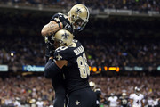 Jimmy Graham #80 of the New Orleans Saints celebrates a touchdown with Kenny Stills #84 during the first quarter of a game against the Baltimore Ravens at the Mercedes-Benz Superdome on November 24, 2014 in New Orleans, Louisiana.