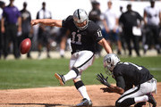 Sebastian Janikowski #11 of the Oakland Raiders scores a field goal in the second quarter against the Baltimore Ravens at Oakland-Alameda County Coliseum on September 20, 2015 in Oakland, California.