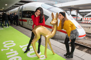 Rebecca Mir (L) and Annemarie Carpendale pose with a giant mockup of a Bambi trophy before they travel with the trophies to the Bambi Awards in Berlin by train at Munich Central Station on November 15, 2018 in Munich, Germany. The 70th Bambi Awards will take place on November 16, 2018 in Berlin.