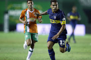Carlos Tevez of Boca Juniors fights for the ball with Juan Alvarez of Banfield during a match between Banfield and Boca Juniors as part of Argentina Superliga 2017/18  on February 18, 2018 in Buenos Aires, Argentina.