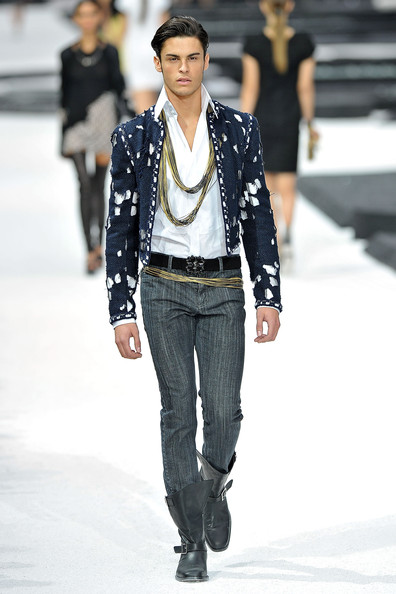 Baptiste Giabiconi Model Baptiste Giabiconi walks the runway during the Chanel Ready to Wear Spring/Summer 2011 show during Paris Fashion Week at Grand Palais on October 5, 2010 in Paris, France.