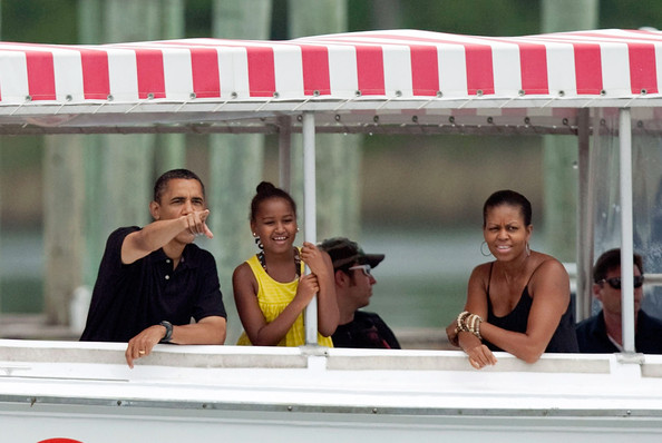 Barack Obama (AFP OUT) U.S. President Barack Obama, first lady Michelle Obama and daughter Sasha watch dolphins as they tour St Andrews Bay on the Bay Point Lady August 15, 2010 In Panama City Beach, Florida. The First Family is visiting the area to help promote tourism and check up on cleanup efforts from the aftermath of the Deepwater Horizon Oil spill.