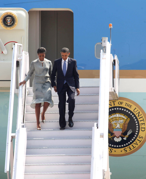 Barack Obama US President Barack Obama and his wife First Lady Michelle Obama descend the steps of Air Force One as they disembark on arrival at Chhatrapati Shivaji International airport on November 6, 2010 in Mumbai, India. The US President began his 10-day Asia tour in India where he is staying at Mumbai's Taj Mahal Palace hotel, the scene of a terrorist attack in 2008. During his tour the President will also visit Indonesia, South Korea and Japan.