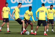 Sergio Busquets and Ansu Fati of FC Barcelona compete for the ball during a training session at Ciutat Esportiva Joan Gamper on May 19, 2020 in Barcelona, Spain. Spanish LaLiga clubs are back training in groups of up to 10 players following the LaLiga's 'Return to Training' protocols.