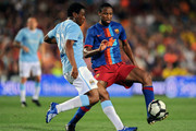 Kelvin Etuhu (L) of Manchester City duels for the ball with Toure Yaya of Barcelona during the Joan Gamper Trophy match between Barcelona and Manchester City at the Camp Nou Stadium on August 19, 2009 in Barcelona, Spain. Manchester City won the match 1-0.