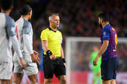 Match Referee Bjorn Kuipers  speaks with Luis Suarez of Barcelona and Virgil van Dijk of Liverpool during the UEFA Champions League Semi Final first leg match between Barcelona and Liverpool at the Nou Camp on May 01, 2019 in Barcelona, Spain.