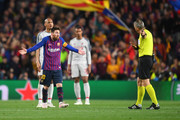 Lionel Messi of Barcelona reacts towards match referee Bjorn Kuipers during the UEFA Champions League Semi Final first leg match between Barcelona and Liverpool at the Nou Camp on May 01, 2019 in Barcelona, Spain.