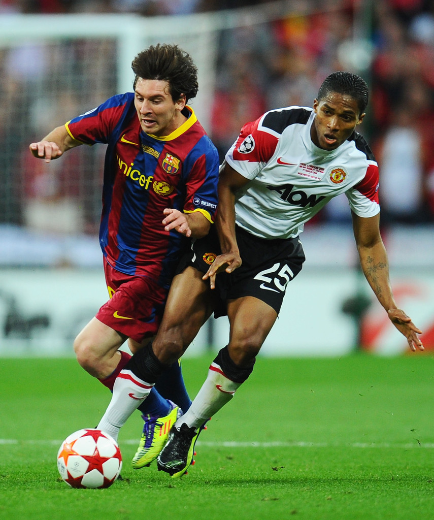 Liverpool Barcelona V S Man Unt Real Madrid: Lionel Messi Luis Antonio Valencia Photos