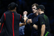 Jamie Murray of Great Britain and John Peers of Australia (R) shake hands with Mike Bryan of the USA and Bob Bryan of the USA (L) after their defeat in their men's doubles match on day five of the Barclays ATP World Tour Finals at the O2 Arena on November 19, 2015 in London, England.