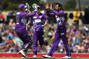 Shoaib Malik of the Hurricanes celebrates with team mates after taking the wicket of Ben Rohrer of the Renegades during the Big Bash League match between the Hobart Hurricanes and the Melbourne Renegades at Blundstone Arena on January 1, 2014 in Hobart, Australia.