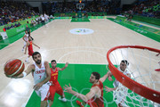 Krunoslav Simon #7 of Croatia shoots the ball over Rudy Fernandez #5 of Spain during a Men's preliminary round basketball game between Croatia and Spain on Day 2 of the Rio 2016 Olympic Games at Carioca Arena 1 on August 7, 2016 in Rio de Janeiro, Brazil.