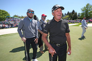 Entertainer Mark Wahlberg (L) and former professional golfer Gary Player of South Africa walk off the green on the ninth hole for the Celebrity Shootout of the PGA TOUR Champions Bass Pro Shops Legends of Golf at Big Cedar Lodge on April 28, 2019 in Ridgedale, Missouri.