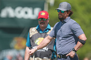 Entertainer Mark Wahlberg talks with walks to his ball during the second round of the PGA TOUR Champions Bass Pro Shops Legends of Golf at Big Cedar Lodge on April 27, 2019 in Ridgedale, Missouri.