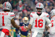 Quarterback J.T. Barrett #16 of the Ohio State Buckeyes (right) is congratulated by wide receiver Braxton Miller #1 (left) after a second quarter touchdown during the BattleFrog Fiesta Bowl against the Notre Dame Fighting Irish at University of Phoenix Stadium on January 1, 2016 in Glendale, Arizona.