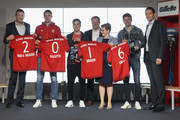 Bayern Muenchen marketing director Andreas Jung, Bayern Muenchen goalkeeper Manuel Neuer, Mario Goetze, P&G communication director Gabriele Hssig and Thomas Mueller (L-R) smile during the official presentation of the new FC Bayern Muenchen sponsoring partner Procter & Gamble at Allianz Arena Erlebniswelt on April 20, 2016 in Munich, Germany.