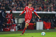 Thomas Mueller of FC Bayern Muenchen runs with the ball  during the DFB Cup match between Bayern Muenchen and Borussia Dortmund at Allianz Arena on December 20, 2017 in Munich, Germany.
