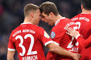 Thomas Mueller of Bayern Muenchen celebrates after scoring his sides second goal with Joshua Kimmich of Bayern Muenchen during the DFB Cup match between Bayern Muenchen and Borussia Dortmund at Allianz Arena on December 20, 2017 in Munich, Germany.