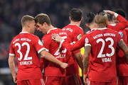 Thomas Mueller of Bayern Muenchen celebrates scoring his teams second goal with teammate Joshua Kimmich during the DFB Cup match between Bayern Muenchen and Borussia Dortmund at Allianz Arena on December 20, 2017 in Munich, Germany.
