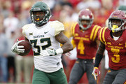 Running back Shock Linwood #32 of the Baylor Bears drives the ball into the end zone for a touchdown pas defensive back Evrett Edwards #4, and defensive back Mike Johnson #3 of the Iowa State Cyclones in the first half of play at Jack Trice Stadium on October 1, 2016 in Ames, Iowa.